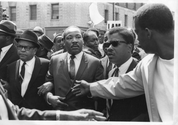Martin Luther King Jr. is jostled in