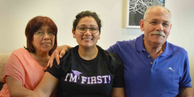 A graduate and her parents celebrate first-generation colle